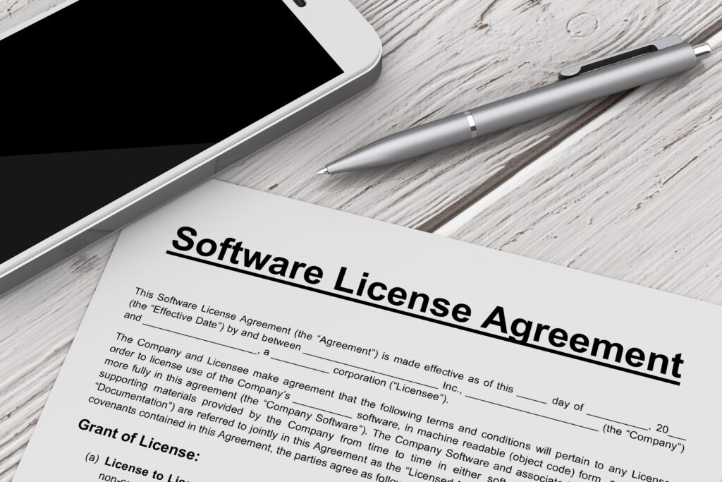 Software,License,Agreement,With,Mobile,Phone,And,Pen,On,A